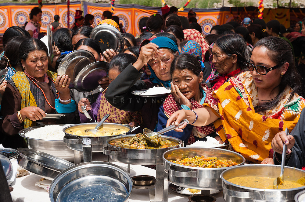 Women at a buffet during a temple opening festival in Arzu, Ladakh, India. Photo © Robert van Sluis