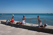 Men exercising abdominals on the seafront in Cascais, near Lisbon, Portugal.