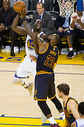Cleveland Cavaliers forward LeBron James (23) fouls Golden State Warriors forward Draymond Green (23) during Game 1 of the NBA Finals at Oracle Arena in Oakland, Calif., on June 1, 2017. (Stan Olszewski/Special to S.F. Examiner)