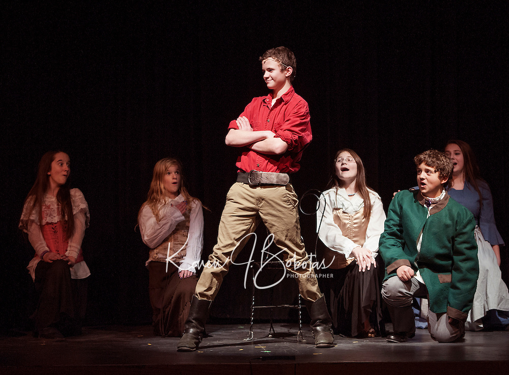 """Gaston (Shea Therrrien) and Lefou (Luke Harding) surrounded by the """"silly girls"""" during dress rehearsal for """"Beauty and the Beast"""" with Gilford Middle School Tuesday afternoon.  (Karen Bobotas/for the Laconia Daily Sun)"""