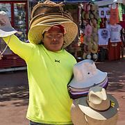North America, Latin America, Latin, Caribbean, tropical, Mexico, Yucatan, Chichen Itza, Xchen Itza, Maya, Mayan, UNESCO World Heritage Site, <br /> Man selling his wares at historic Chichen Itza, Yucatan, Maxico.