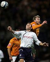 Photo: Paul Thomas/Sportsbeat Images.<br /> Preston North End v Hull City. Coca Cola Championship. 04/12/2007.<br /> <br /> Chris Sedgwick (L) of Preston headers away from Stephen McPhee.