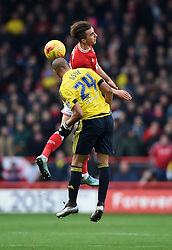 Joe Bryan of Bristol City battles for the high ball with, Emilio Nsue of Middlesbrough  - Mandatory byline: Joe Meredith/JMP - 16/01/2016 - FOOTBALL - Ashton Gate - Bristol, England - Bristol City v Middlesbrough - Sky Bet Championship