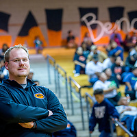 The new Bengal varsity football coach, Chris Winkler, poses for a portrait at Gallup High School Jan 6.
