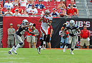 September 13, 2009, Tampa, Florida, USA;  Michael Clayton(80) of the Tampa Bay Buccaneers goes up for a pass between Mike Jenkins(21), and Pat Watkins(25) of the Dallas Cowboys in a 34-21 loss to the Cowboys at Tampa's Raymond James Stadium.
