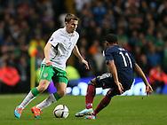Seamus Coleman of Irelandtakes on Ikechi Anya of Scotland  - UEFA Euro 2016 Qualifier - Scotland vs Republic of Ireland - Celtic Park Stadium - Glasgow - Scotland - 14th November 2014  - Picture Simon Bellis/Sportimage