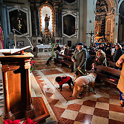 VENICE, ITALY - JANUARY 15:  Don Filippo Chiafoni Chaplain of the Church of S Francesco blesses the congregation and their animals during a special service held on January 15, 2012 in Venice, Italy. The blessing of animals and pets is a very ancient tradition dating back from San Francis of Assisi.