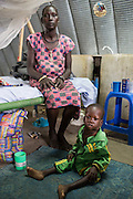 """Mcc0075406 . Daily Telegraph<br /> <br /> DT Foreign<br /> <br /> Hellen Apuok with her son  2.5 yr old son Emmanuel who is receiving treatment for malnutrition .<br /> <br /> The IMC Paediatric ward in POC 3 , a """"Protection of Civilian Camp"""" inside the vast UN compound on the outskirts of Juba . Parents bring their children in with acute malnutrition needing urgent treatment .<br /> <br /> Over 20,000 civilians who predominantly fled from conflict in the equatorial states of South Sudan . United Nation's agencies recently announced a famine in the war torn country .<br /> <br /> Juba 27 February 2017"""