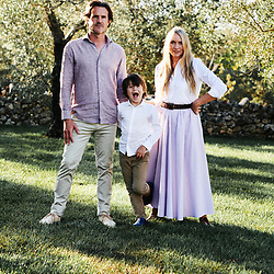 Collette Dinnigan, her husand Bradley Cocks and their son Hunder posing in their villa's garden. Ostuni, Italia. September 28, 2019.
