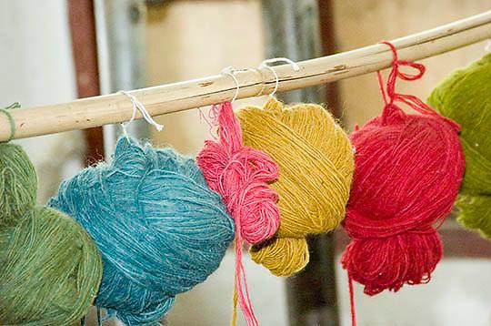 Dyed yak wool yarn hanging in rug factory. Tibet. Asia.