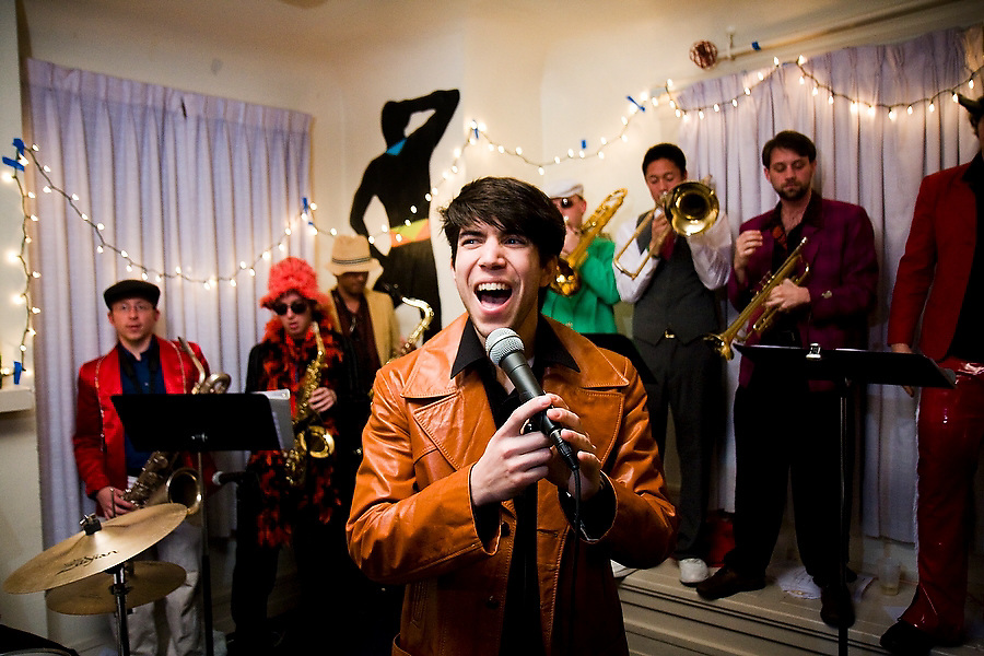 Singer Jimmy Delgadillo and the rest of the 12-piece Stanford student band TGIFunk performs at the Maison Francaise student house in Stanford, California on February 15, 2008.