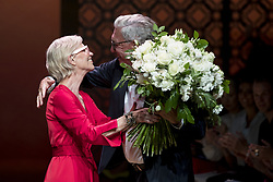 July 3, 2018 - Berlin, Germany - Label Founder Helmut Schlotterer (R) gives a bunch of flowers to Fashion Designer Karin Veit (L) at the end of the Marc Cain Spring/Summer 2019 Fashion Show at Westhafen in Berlin, Germany on July 3, 2018. Chef of Design Karin Veit is leaving the label after 43 years. (Credit Image: © Emmanuele Contini/NurPhoto via ZUMA Press)