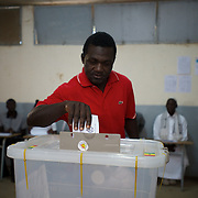 February 26, 2012 - Dakar, Senegal: A senegalese man casts his vote for the senegalese presidential elections at a polling station in Franco-Arab School in Point E area of Dakar. Hundreds arriving for voting in the early hours. (Paulo Nunes dos Santos/Polaris)