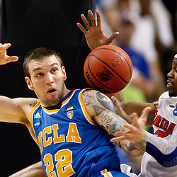 Mar 19, 2011; Tampa, FL, USA; UCLA Bruins forward Reeves Nelson (22) and Florida Gators forward Alex Tyus (23) battle for a loose ball during second half of the third round of the 2011 NCAA men's basketball tournament at the St. Pete Times Forum. Florida defeated UCLA 73-65.  Mandatory Credit: Derick E. Hingle
