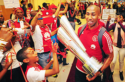 Cape Town - 150920 - Pictured holding the cup is Nathan Paulse, who scored the winning goal in the final. Ajax Cape Town came home to a hero's welcome as fans laid out a red carpet for them at the domestic arrivals of of the Cape Town International Airport. Ajax Cape Town are the 2015 MTN8 champions following a 1-0 win over Kaizer Chiefs at the Nelson Mandela Bay Stadium on Saturday afternoon. Reporter: Gadeeja Abbas Picture: David Ritchie