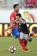 Costa Rica's Randall Azofeifa (14), left, and Paraguay's Celso Ortiz (16) collide while going for the ball during the second half of a Copa America group A soccer match at Camping World Stadium in Orlando, Fla., Saturday, June 4, 2016. The match finished, 0-0. (Phelan M. Ebenhack via AP)