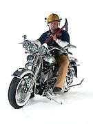 Wind & Fire motorcycle club member on his custom Harley Davidson motorcycle.  Wind & Fire club consists of fireman who ride Harley Davidson motorcycles.