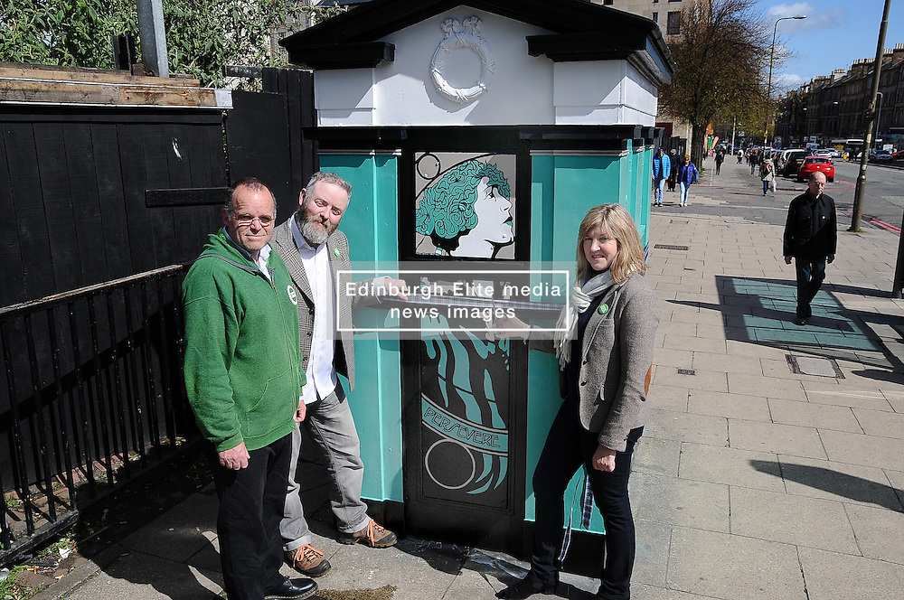 Scottish Green party candidates for the Lothians Alison Johnstone (right) and Andy Wightman (left) officially unveil the latest piece of art by Leith-based artist Stewart Bremner (centre), a specially-designed and painted decommissioned police box on Leith Walk, Edinburgh.<br /> <br /> <br /> © Dave Johnston/ EEm