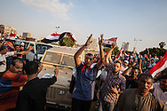 Crowds cheer as the military drives through central Cairo, a day prior to their deadline warning of a military take over unless there are political reforms.