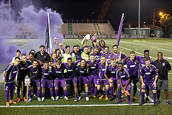 12 July 2016. New Orleans, Louisiana.<br /> NPSL Soccer, Pan American Stadium.<br /> New Orleans Jesters v UANL Tigres from Monterrey, Mexico. <br /> Jesters draw 1-1 at full time, going on to lose the penalty shoot out.<br /> Jesters pose with loyal fans from the Royal Court.<br /> Photo; Charlie Varley/varleypix.com