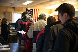 """A long line formed at Douglas Town Hall on Election Day on Tuesday, November 6, 2018, in the area of Douglas Township, Minn. The town hall has 494 registered voters and has a steady flow of people throughout the day. It also has a sign out front that says """"If you need curbside voting honk three times and we will bring you a ballot"""" meant for elderly or disabled people. Photo by Renee Jones Schneider/Minneapolis Star Tribune/TNS/ABACAPRESS.COM"""
