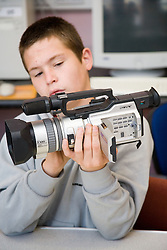 Entry 2 Employment student learning about the video camera he will be using during a video project; Sycamore Centre Nottingham,
