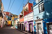 View of the colorful buildings a cobblestone street in the historic center of Guanajuato City, Guanajuato, Mexico.