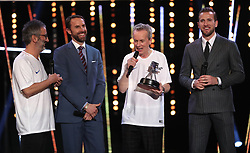 Gareth Southgate receives his award for Coach of the Year from David Baddiel and Frank Skinner during the BBC Sports Personality of the Year 2018 at Birmingham Genting Arena.