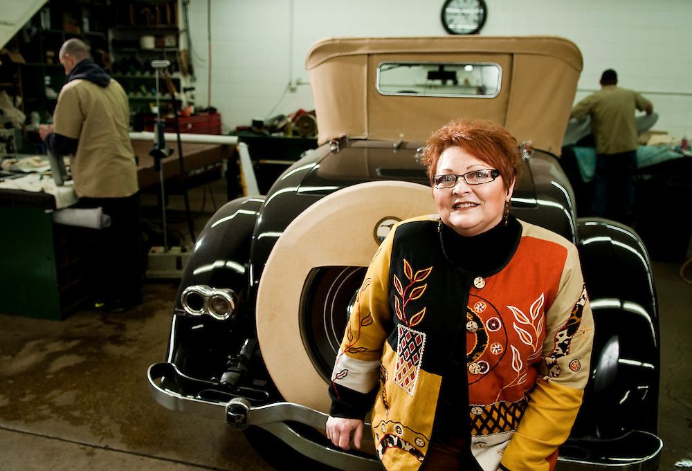 Matt Dixon   The Flint Journal..Deborah Schultz-Pawlosky poses next to a rare 1926 Wills Sainte Claire at C. H. Schultz & Sons, Inc. an interior repair and restoration company on Pasadena Avenue in Flint. Schultz-Pawlosky, now president of the company, purchased the business from her father, Clyde D. Jr. in 1997. Clyde H. Schultz began the business in 1917 with horse drawn and motor driven vehicles and eventually turned it into a full time career passes the buisness down through several generations.