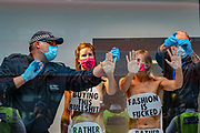 A police protestors removal unit is working to release Extinction Rebellion activists have glued themselves to the shop window of H&M in Oxford street in London on Wednesday, Sept 9, 2020. The activists are completely naked, except for strategically placed placards that made a statement about social and environmental injustice in the fashion industry. The signs read 'Fashion is F*cked, Rather Be Naked', 'Won't Wear Injustice, Rather be Naked' and 'Not Buying This Bullshit, Rather Be Naked'. Environmental nonviolent activists group Extinction Rebellion enters its 9th day of continuous ten days protests to disrupt political institutions throughout peaceful actions swarming central London into a standoff, demanding that central government obeys and delivers Climate Emergency bill. (VXP Photo/ Vudi Xhymshiti)