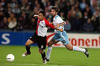 Fotball, 21. oktober 2004, Feyenoord - Heart of Midlothian , UEFA cup , Shinji Ono in duel met Paul Hartley<br /> Norway only