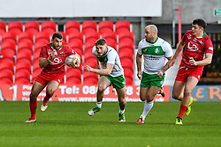 11th November 2018 , Racecourse Ground,  Wrexham, Wales ;  Rugby League World Cup Qualifier,Wales v Ireland ; Elliot Kear of Wales breaks the Ireland defensive line<br /> <br /> <br /> Credit:   Craig Thomas/Replay Images