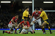 Rhys Priestland of Wales © makes a break. Dove Men, autumn international test, Wales v Australia at the Millennium Stadium in Cardiff on Sat 1st Dec 2012. pic by Andrew Orchard, Andrew Orchard sports photography,
