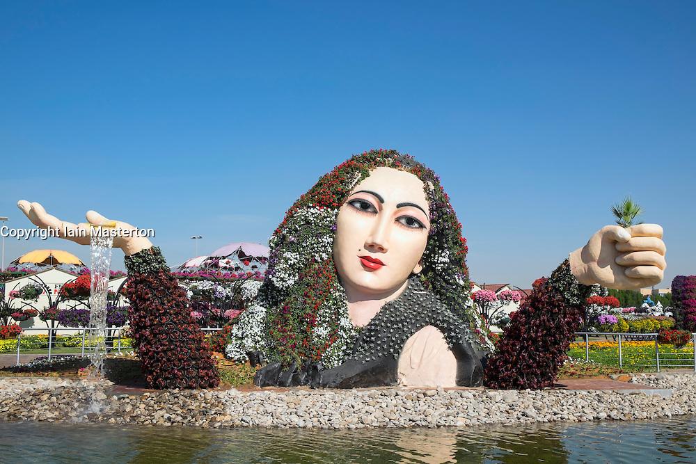 Flower display on female figure at  Miracle Garden the world's biggest flower garden in Dubai United Arab Emirates