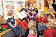 """Nationaal Voorleesontbijt in Den Haag. Princes  Laurentien leest kinderen voor in de Centrale Haagse Bibliotheek. De princes Leest het boek """"Anton kan toveren"""" van Ole Konnecke voor, dat het prentenboek van 2009 is geworden.<br /> <br /> <br /> <br /> Princess Laurentien is Reading a book for children to promote reading to children in the Central Libary in The Hague."""