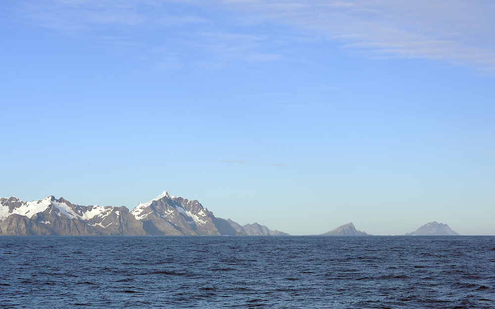 Willis Island (right) and Bird Island separated by Stewart Strait across Church Bay off the north-western end of South Georgia.  Snow Peak is in the centre and Cape North to the left. South Georgia. 19Feb16