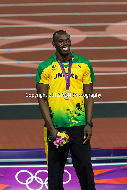 Usain Bolt (JAM) with his gold medal for winning Men's 200m Final at the Olympic Summer Games, London 2012