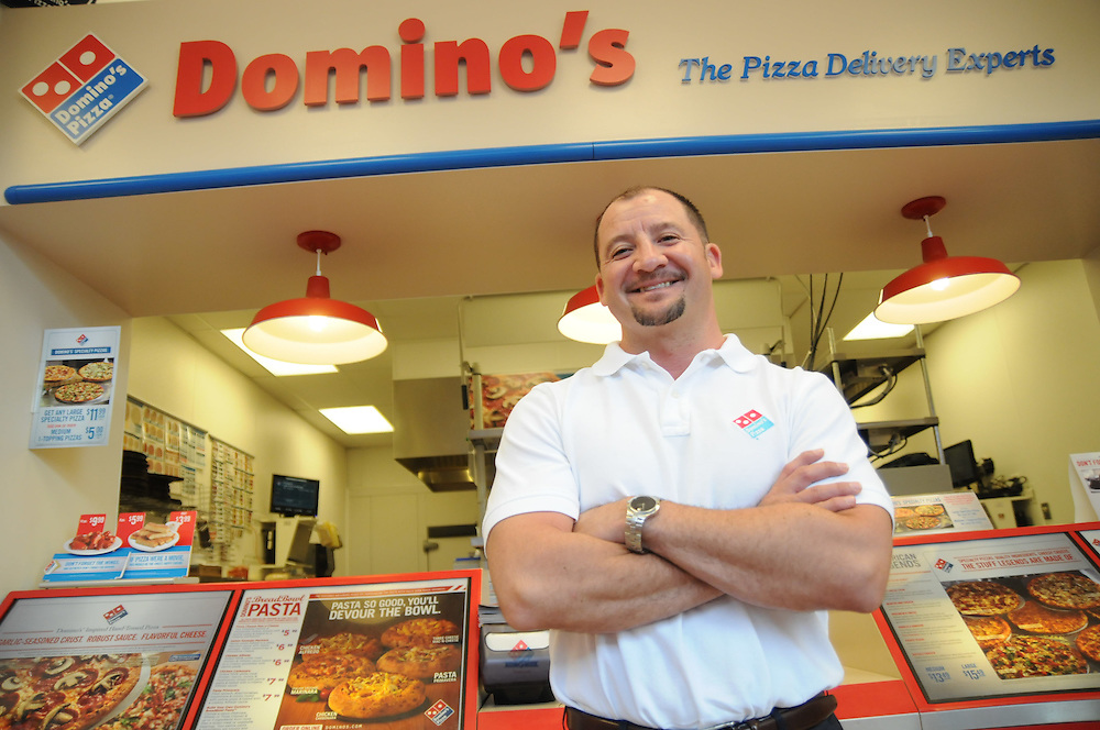 """Mauricio """"Reece"""" Arroyave is an Domino's Pizza franchise owner, operating 4 store in Chicago's northwest suburbs."""