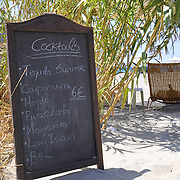 Cafe menu board with cocktails in Plakias beach, Crete