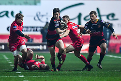 Dragons' Sam Beard breaks the tackle of Scarlets' Steffan Hughes<br /> <br /> Photographer Craig Thomas/Replay Images<br /> <br /> Guinness PRO14 Round 13 - Scarlets v Dragons - Friday 5th January 2018 - Parc Y Scarlets - Llanelli<br /> <br /> World Copyright © Replay Images . All rights reserved. info@replayimages.co.uk - http://replayimages.co.uk