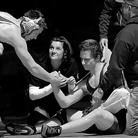 Ridgeview's Brent Yeakey  shakes hands with Redmond's Harley Todd after breaking his arm during 170-pound match Thursday at Redmond.