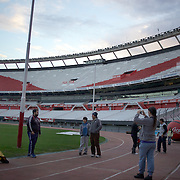 Fans take pictures of River Plate stadium during a stadium tour group visit to River Plates' El Monumental stadium, Buenos Aires, Argentina, 25th June 2010. Photo Tim Clayton....