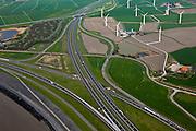 Nederland, Friesland, gemeente Wonseradeel, 28-04-2010; verkeersknoopppunt Zurich aan het eind van de Afsluitdijk, met windmolens in de Gooijumer- en Zuricherpolder.Intersection and wind mills.luchtfoto (toeslag), aerial photo (additional fee required).foto/photo Siebe Swart.Makkumerwaard