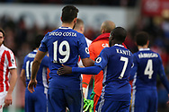 Diego Costa of Chelsea and N'Golo Kante of Chelsea embrace at the end of the game. Premier league match, Stoke City v Chelsea at the Bet365 Stadium in Stoke on Trent, Staffs on Saturday 18th March 2017.<br /> pic by Andrew Orchard, Andrew Orchard sports photography.