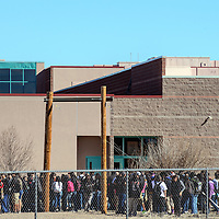 020615       Adron Gardner<br /> <br /> Students line up on campus after as emergency responders investigate a gas leak at Gallup High School Friday.