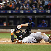 NEW YORK, NEW YORK - APRIL 12: Giancarlo Stanton, Miami Marlins, avoids a high pitch from Jim Henderson, New York Mets, during the Miami Marlins Vs New York Mets MLB regular season ball game at Citi Field on April 12, 2016 in New York City. (Photo by Tim Clayton/Corbis via Getty Images)