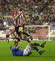 Photo. Glyn Thomas.<br /> Sunderland v Birmingham. FA Cup fifth round.<br /> Stadium of Light, Sunderland. 14/02/2004.<br /> Sunderland's goalscorer Kevin Kyle (T) leaps over a challenge from Kenny Cunningham.