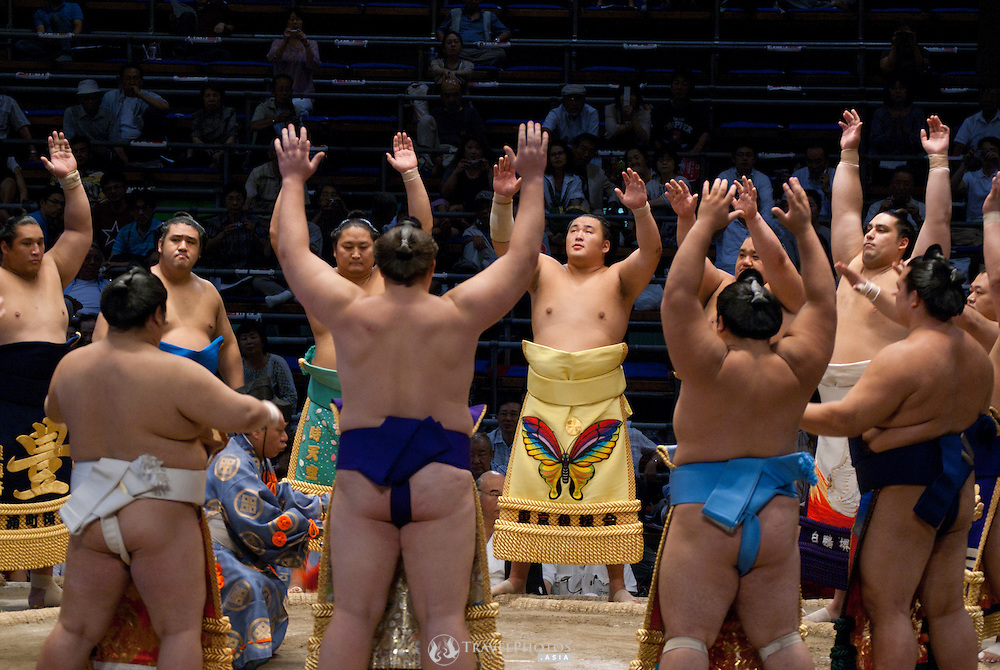 Wrestlers wearing their sponsors' garb during the ring entering ceremony ahead of their bouts. The July summer Grand Sumo Tournament held in Nagoya.