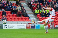 Doncaster Rovers midfielder Ben Whiteman has a shot at goal but goes high over the bar during the EFL Sky Bet League 1 match between Doncaster Rovers and Bradford City at the Keepmoat Stadium, Doncaster, England on 22 September 2018.
