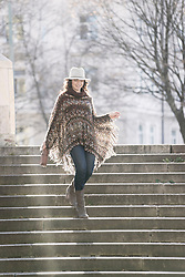 Mature woman moving down on staircases, Bavaria, Germany